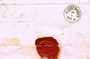 Bagsiden af brevet med ankomststemplet ANT V-3 3.7. Brugsperiode: 1861 – 1871.